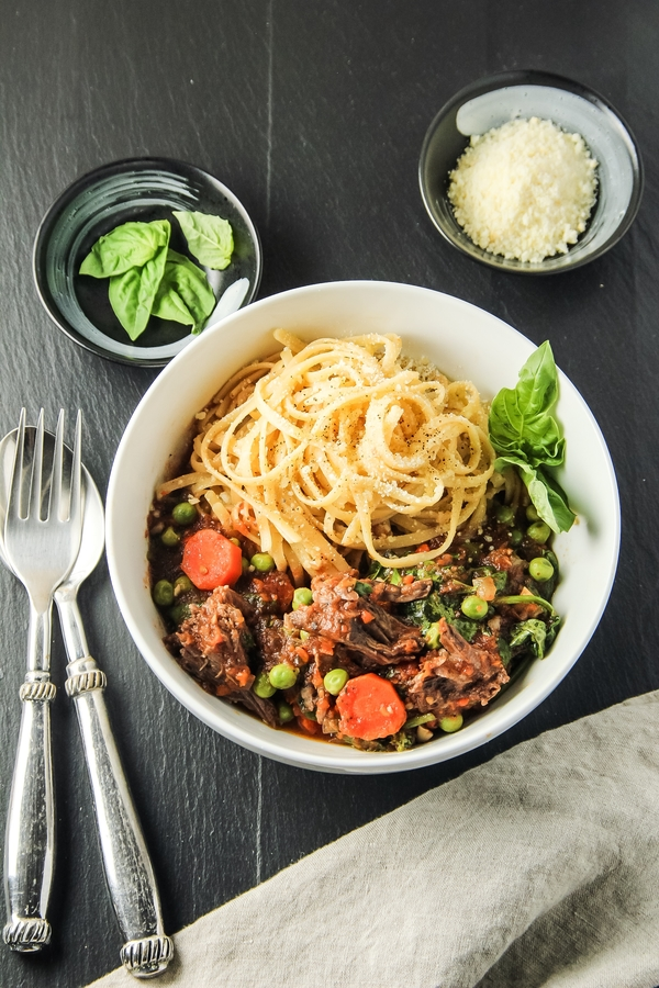 Slow-Cooked Beef in Tomato Sauce with Spinach and Peas